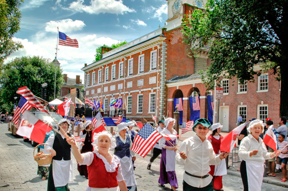A Parade passes in front of Independence Hall